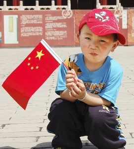 Chinese boy with flag